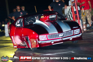 Chuck Mohn's Gorgeous Pro Mod Camaro lighting the pipes on the hit