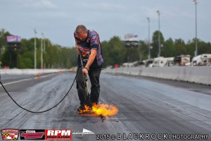 Jason Miller of MDIR gets the track ready for superb pro modified racing